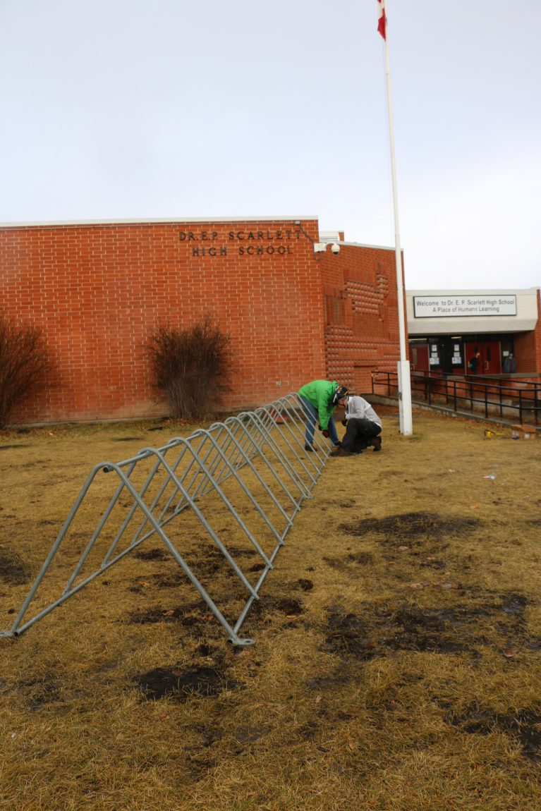 volunteers install bike racks